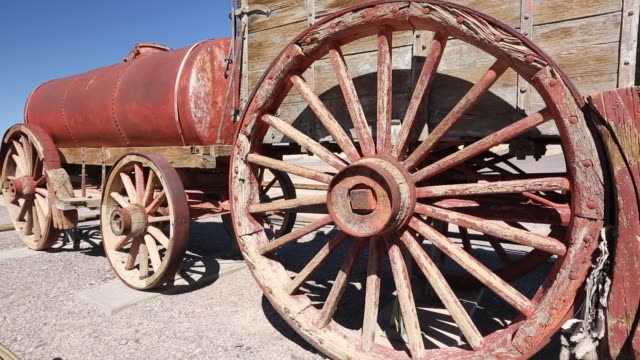 an old wagon train at the harmony borax works in death valley which is the lowest, hottest, driest place in the usa, with an average annual rainfall... - death valley national park stock videos & royalty-free footage