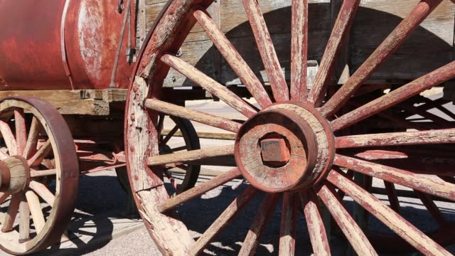 an old wagon train at the harmony borax works in death valley which is the lowest, hottest, driest place in the usa, with an average annual rainfall of around 2 inches, some years it does not receive any rain at all. - wheel stock videos & royalty-free footage