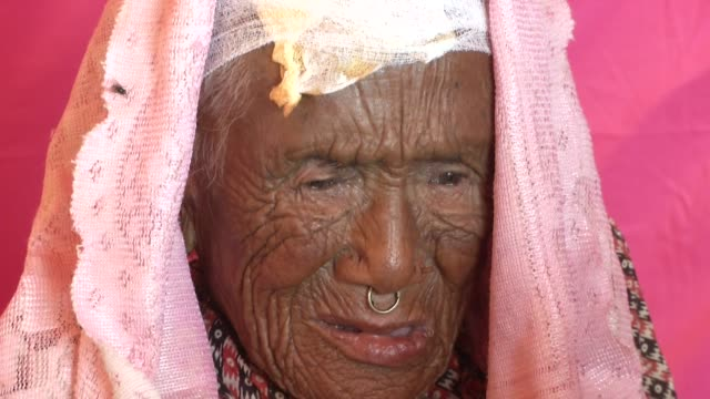 An old woman recovers at a field hospital in Chautara / A major earthquake hit Kathmandu midday on Saturday April 25th and was followed by multiple...