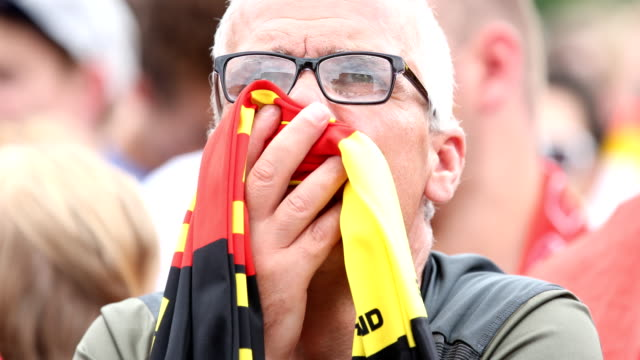 vídeos y material grabado en eventos de stock de an older german fan with a scarf in the colors of the german flag gets upset after germany lost the 2018 fifa world cup russia group f match against... - bufanda