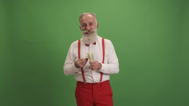 an older man shows money and smiles - suspenders stock videos & royalty-free footage