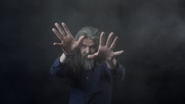 an older man with long hair and a beard - magician stock videos & royalty-free footage