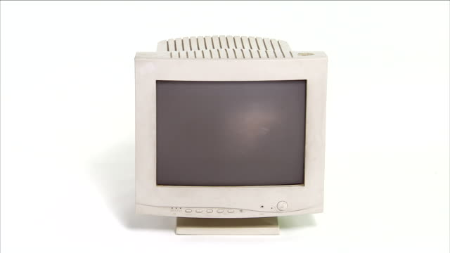 an older model computer monitor is surrounded by a white background. - computer monitor white background stock videos & royalty-free footage
