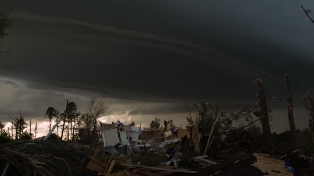 an ominous looking cloud hangs above the remains of a home that was destroyed yesterday by a tornado on april 29, 2014 in tupelo, mississippi. a... - ominous stock videos & royalty-free footage
