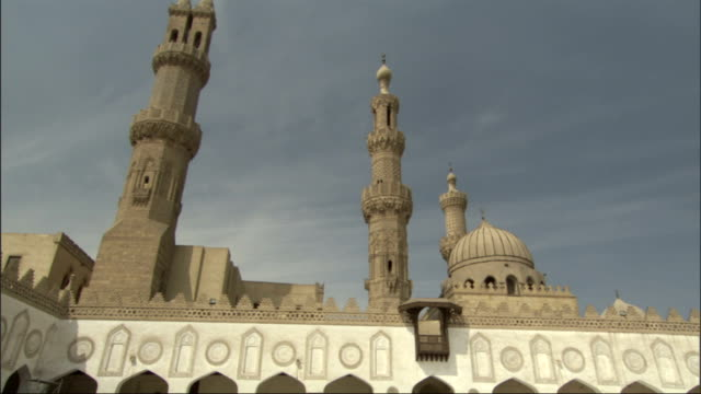an onion dome and minarets overlook the courtyard of a beautiful mosque. - onion dome stock videos and b-roll footage