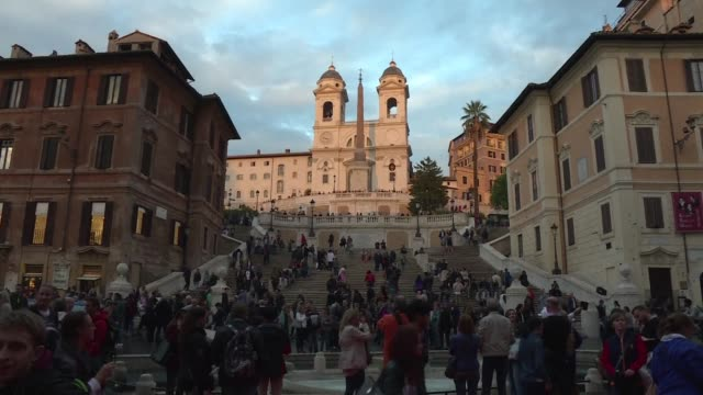 an open air screening of roman holiday in piazza di spagna a long red carpet and four identical vespas to the one ridden by gregory peck the rome... - gregory peck stock videos and b-roll footage