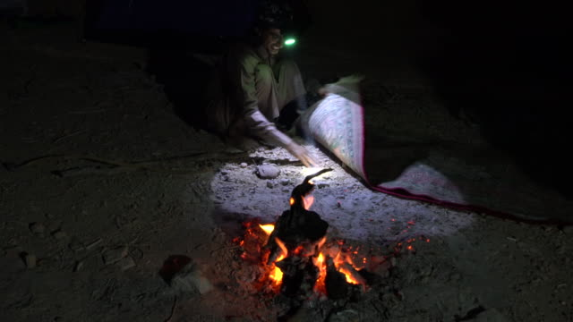 an open fire at a bedouin camp in wadi rum desert, jordan - sandstone stock videos & royalty-free footage