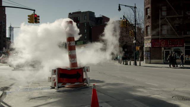 An open steam vent on 7th Avenue South in New York City in slow motion.