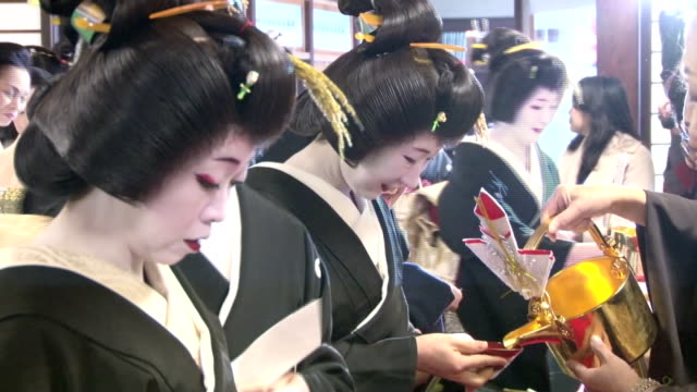 vídeos de stock, filmes e b-roll de an opening ceremony marked new year's start of art schools for geiko and maiko traditional dancers in kyoto on wednesday january 7 at gion kobu... - entertainment occupation