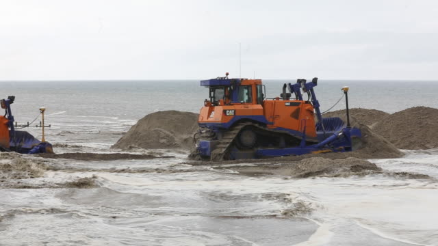 an operation by royal haskoningdhv to protect against erosion of the cliffs bordering the bacton gas terminal in bacton uk on thursday july 18 2019 - horizon over water stock videos & royalty-free footage