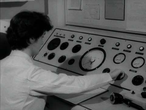an operator adjusts dials on a linear accelerator 1958 - laboratory equipment stock videos & royalty-free footage