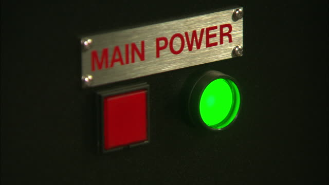 an operator pushes the main power on button. - start button stock videos & royalty-free footage
