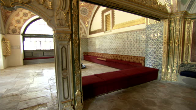 an opulent domed ceiling arches over the sultan's and queen mother's private bathing chamber at the topkapi palace. available in hd. - topkapi palace stock videos and b-roll footage