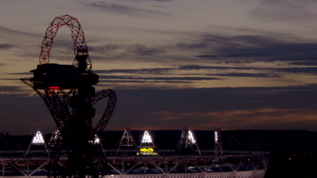 An orange sky turns to night behind the London 2012 Paralympic Stadium and Mittal Orbit Timelapse Paralympic Sunset at Olympic Park on September 01...