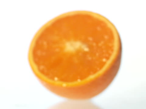an orange. - cut video transition stock videos & royalty-free footage