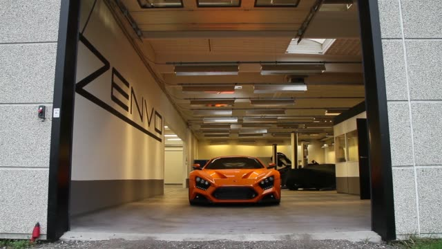 an orange zenvo st1 supercar returns to the workshop after testing at the headquarters of zenvo automotive in praestoe denmark on friday nov 14 gvs... - 試運転点の映像素材/bロール