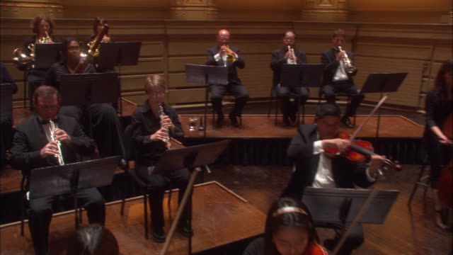 an orchestra performing on the stage. - orchestra stock videos & royalty-free footage