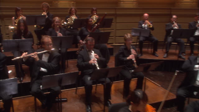 an orchestra playing on the stage in a theater. - orchestra stock videos & royalty-free footage