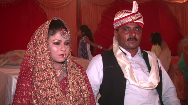 an organisation in pakistan brings dozens of couples together for a mass wedding as a way of alleviating their costs - karachi stock videos and b-roll footage