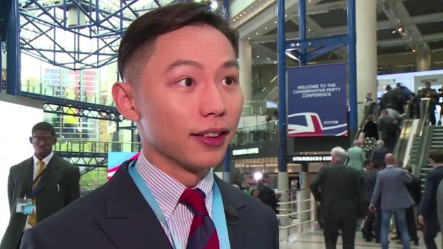 stockvideo's en b-roll-footage met an organiser of a fringe event about hong kong at the uk conservative party's conference says he was slapped by a chinese television reporter who... - hong kong