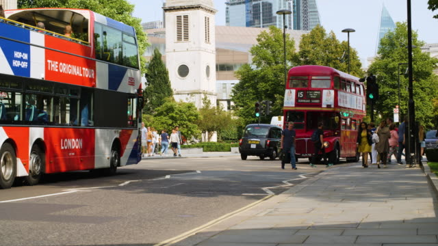 an original aec routemaster bus still in operation drives down st paul's churchyard, city of london - double decker bus stock-videos und b-roll-filmmaterial
