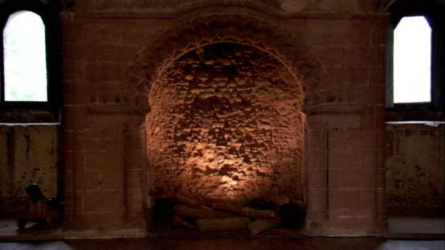 an ornate arch surrounds a large fireplace in hedingham castle. available in hd. - stone material stock videos & royalty-free footage