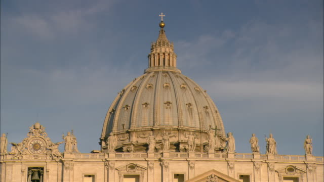 an ornate dome tops st. peter's basilica in vatican city. - dome stock videos & royalty-free footage