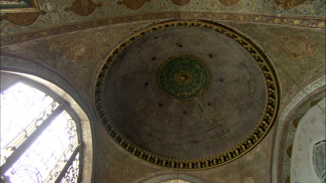 an ornate domed ceiling arches above the sultan's private bathing area at the topkapi palace. available in hd. - topkapi palace stock videos and b-roll footage