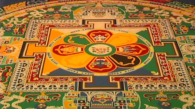 of an ornate red, green, yellow, and blue mandala, showing its intricate carving and symmetry. - mandala stock videos & royalty-free footage