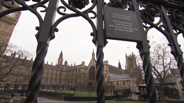 an ornate rod-iron fence stands outside the house of lords at the palace of westminster palace in london. available in hd. - rod stock videos and b-roll footage