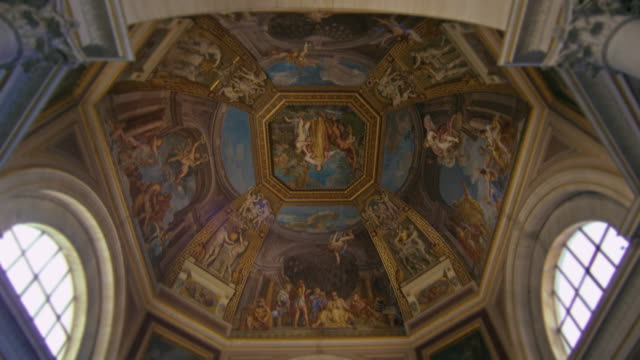 An ornately painted domed ceiling in the Vatican Museum