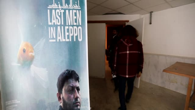 an oscar nominated syrian documentary following rescuers under regime bombardment in aleppo was screened monday before dozens of spectators in the... - documentary film stock videos & royalty-free footage