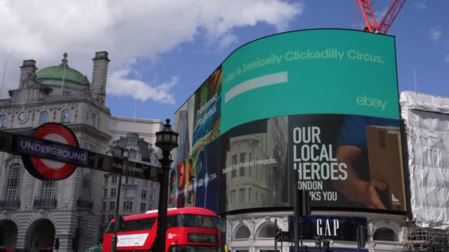 an our local hero advert on the advertising screen at piccadilly circus in london on april 6 as life in britain continues during the nationwide... - advertisement stock videos & royalty-free footage