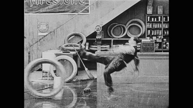 1920 an out of control tire, thrown by man (buster keaton) knocks down men (fatty arbuckle, buster keaton), and their coworker - tyre stock videos & royalty-free footage