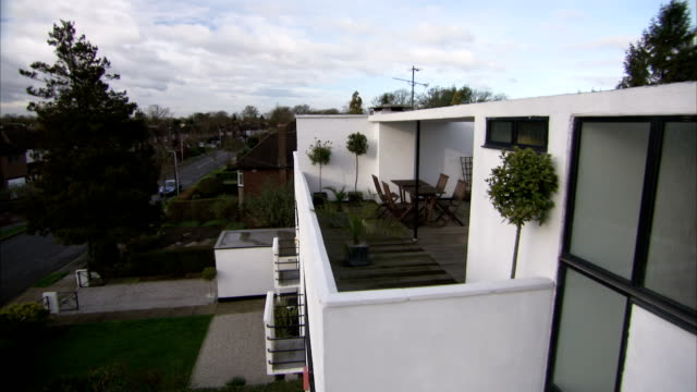 an outdoor dining area tops an art deco house in rayners lane, london. available in hd. - outdoor chair stock videos & royalty-free footage