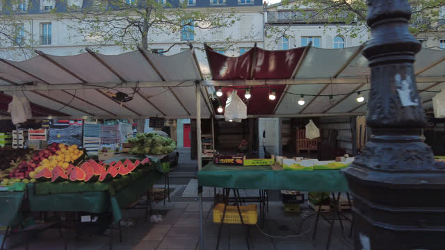 pov of an outdoor market in the street of paris, in spring. market installation - france stock videos & royalty-free footage