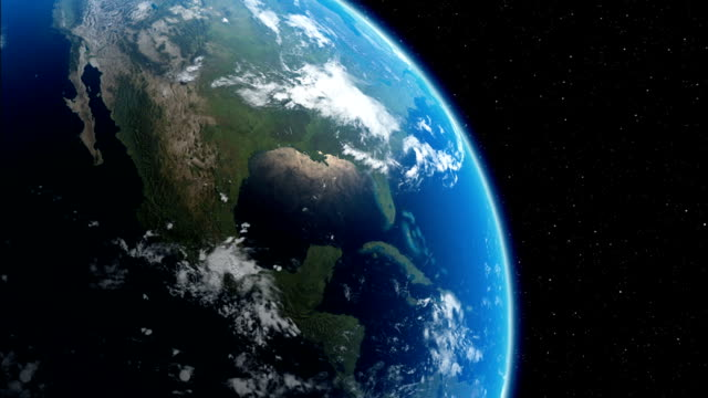 An outer-space image of Earth zooms in on the Yucatan Peninsula. Available in HD.
