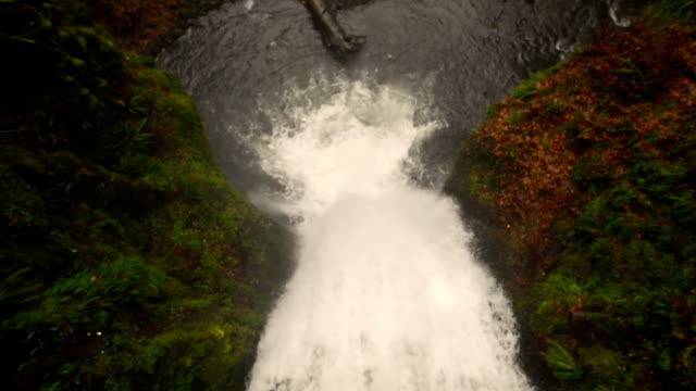 an overhead straight down view of a powerful waterfall crashing below - fatcamera stock videos and b-roll footage