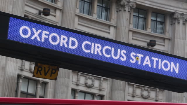 an oxford circus tube station sign is seen on oxford street on october 19 2016 in london england inflation rose to 10% in september up from 06% in... - oxford circus stock videos and b-roll footage
