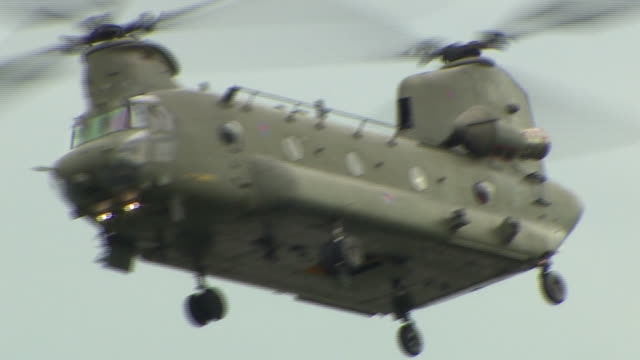 an raf chinook helicopter helping to shore up a riverbank after serious flooding in wainfleet lincolnshire - politics stock videos & royalty-free footage