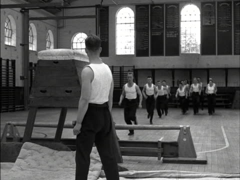 an raf gymnastic team vault over a horse during a training session. 1952. - jumping stock videos & royalty-free footage