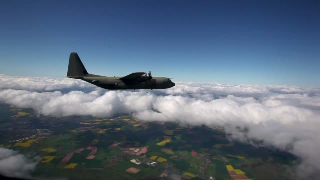 an raf hercules c130 flies over wales during a practice flight after taking off from raf brize norton on may 15 2012 in england two hercules joined... - air force stock videos & royalty-free footage