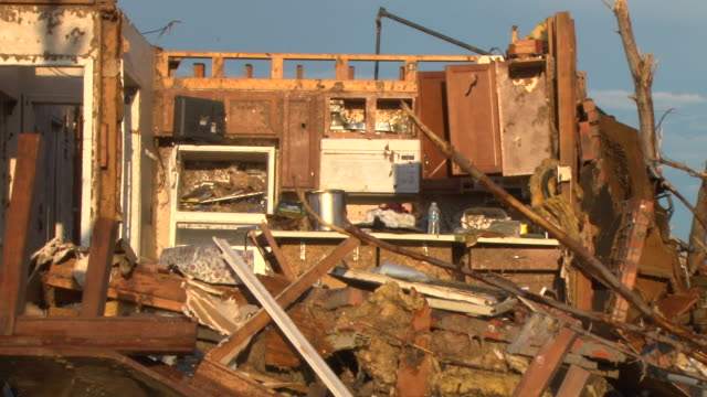 stockvideo's en b-roll-footage met an residential home in moore oklahoma is completely destroyed in the wake of the devastating ef5 tornado on may 20th 2013 - 2013