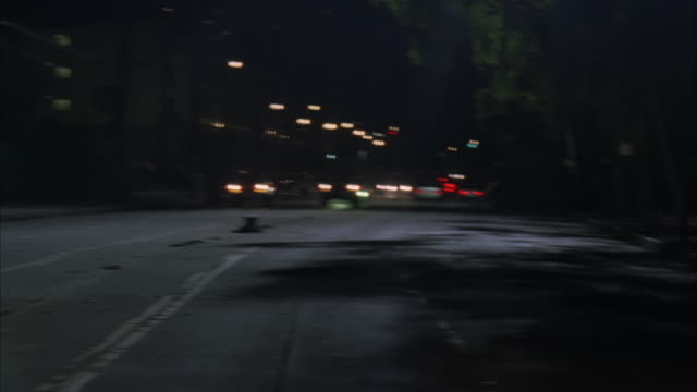 An SUV crashing and rolling on a street.