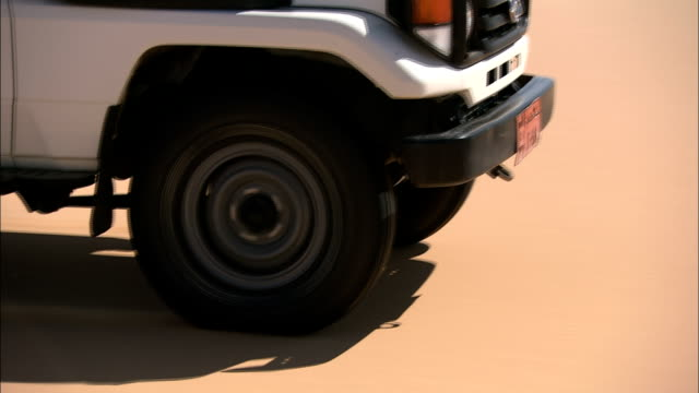 an suv drives through sand. - sports utility vehicle stock videos & royalty-free footage