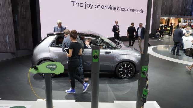 an ubitricity charging column for electric cars stands on display next to a honda e electric car during the press days at the 2019 iaa frankfurt auto... - honda bildbanksvideor och videomaterial från bakom kulisserna