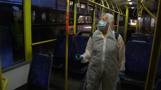 an ukrainian employee wearing protective clothes disinfects an a public trolley bus at a trolleybus depot as part of precautionary measures against... - trolley bus stock videos & royalty-free footage