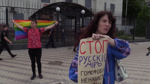 an ukrainian lgbt activist holds a placard reading 'stop russian world homophobia hate war' during a rally demanding russia to investigate the murder... - homophobia stock videos and b-roll footage