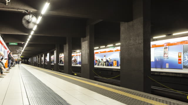 an underground metro station in milan, italy. - stazione video stock e b–roll