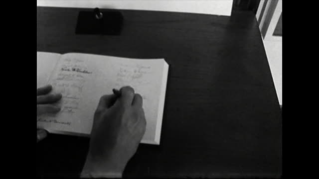 an unidentifiable male wearing a suit signs a condolence book at the american embassy in london after martin luther king's assassination 1968 - stationary stock videos & royalty-free footage